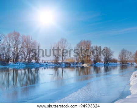 snow-covered winter river in sunny day - stock photo