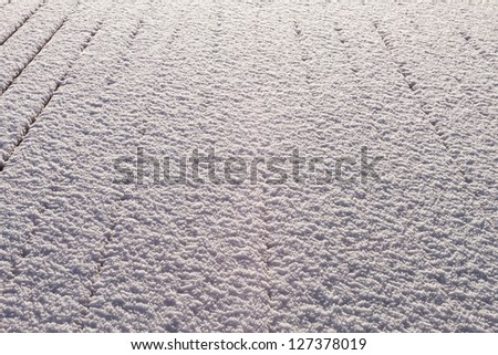 Snow-covered wood terrace floor background - stock photo