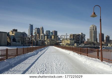 Snow covering the Stone Arch Bridge, Minneapolis, Minnesota, USA - stock photo