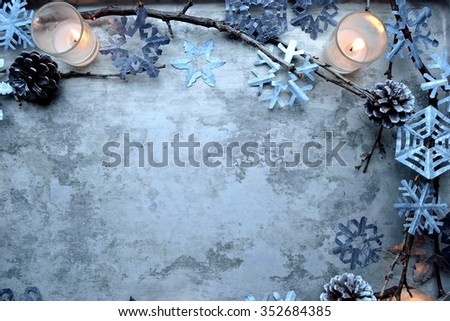 Snow crystal paper cut out,pine cones and candles - stock photo