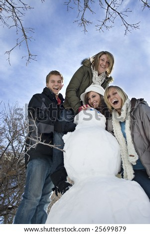 Snow Day Fun with Snowman - stock photo