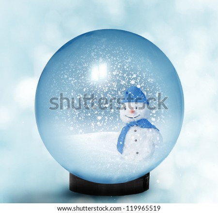 Snow dome with snowman - stock photo