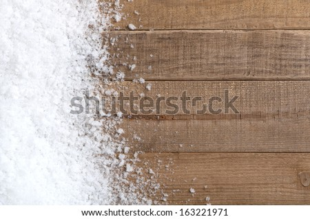 Snow drift on Wood Boards with Blank Space or Room for Copy, Text, or your Words.  Horizontal with warm tones - stock photo