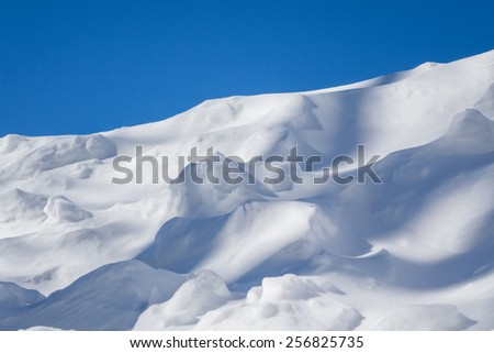 Snow dunes with brilliant blue sky