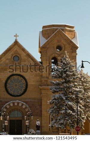 Snow enhances Santa Fe's beautiful St. Francis Cathedral and Basilica - stock photo