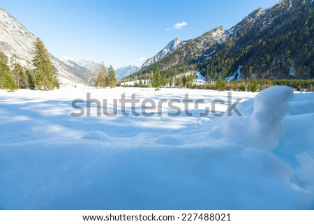 Snow fall early winter and late autumn. Alps landscape with snow capped mountains in the late autumn season. - stock photo