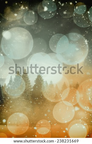 Snow falling against twinkling red and orange lights - stock photo