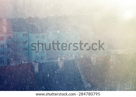snow falling blizzard rooftops christmas winter background stylized backlight - stock photo