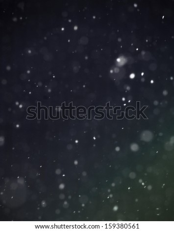 Snow falling on blue and green background - stock photo