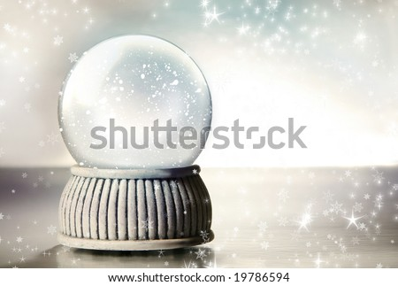 Snow globe against a silver background - stock photo