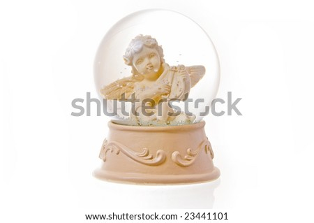 Snow globe with angel isolated on white background. - stock photo