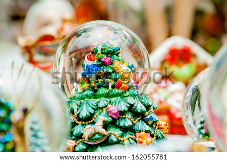 Snow globe with christmas characters - stock photo