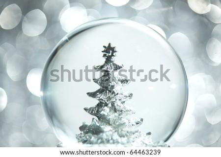Snow globe with Christmas tree - stock photo