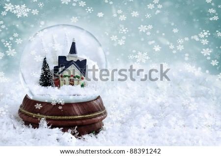Snow globe with church and christmas trees inside. Copy space available. - stock photo