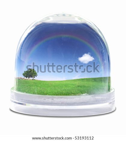 Snow globe with green grass field, blue sky fully white cloud and lone tree - stock photo