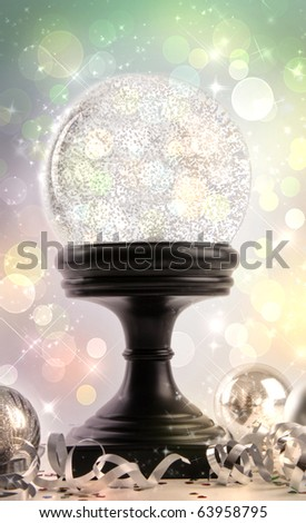 Snow-globe with ornaments against a colored background - stock photo