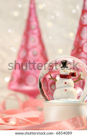 Snow globe with pink christmas trees in a winter white background - stock photo