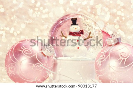 Snow globe with pink ornaments with vintage look - stock photo