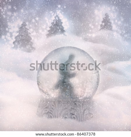 Snow globe with snowman. Winter Christmas background with snow globe - stock photo