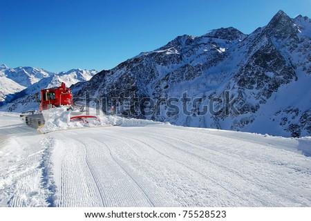 Snow groomer in ski resort in Solden, Austria - stock photo