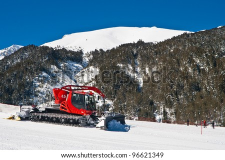 Snow groomer maintaining ski hills