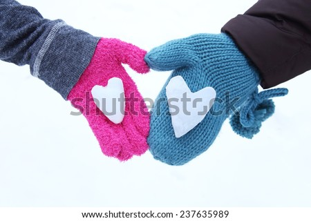 Snow Hearts held in two hands - stock photo