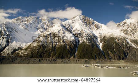 Snow, ice, rock, mountains and plenty of water on the Tasman Glacier, New Zealand.