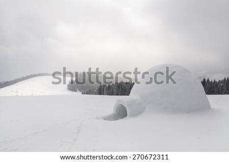snow igloo in the high mountain - stock photo