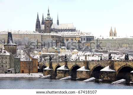 Snow in Prague, gothic Castle with the Charles Bridge