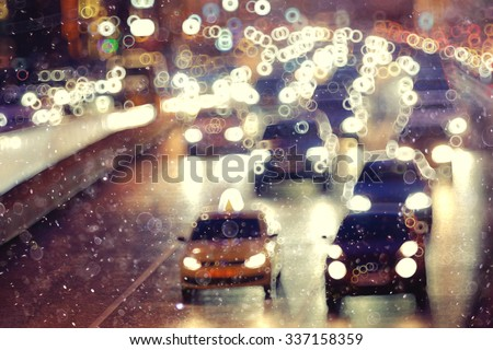 Snow in the city night traffic road transport - stock photo
