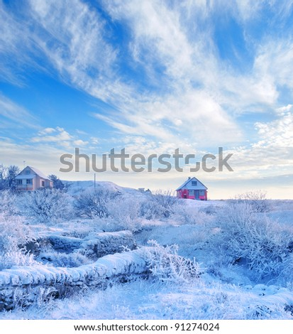 Snow in village, the house on a hill - stock photo