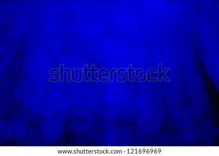 Snow lights and stars are falling on the background of blue luminous rays. - stock photo