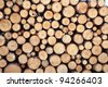 Snow log stack lumber in winter. Woodpile of pine - stock photo