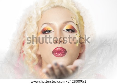 Snow magic image of a girl with blond hair. - stock photo