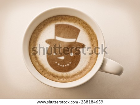 snow man drawing on latte art coffee cup  - stock photo
