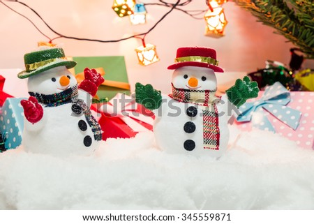 Snow man with the ornament, gifts and presents.wait Santa Claus in Merry christmas and Happy New year Night