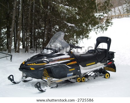 snow mobile on a winter trail - stock photo