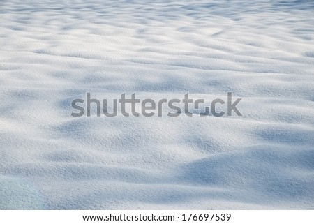 Snow mounds in early morning snow after a fresh new snowfall - stock photo