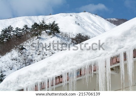 Snow mountain and icicles - stock photo