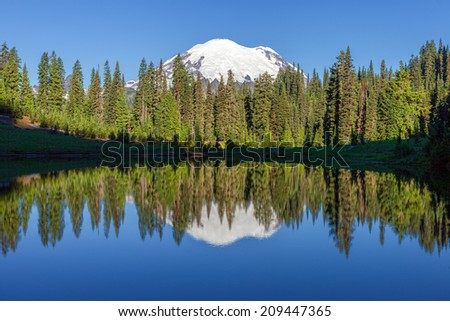 Snow Mountain and Reflection - stock photo