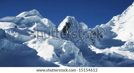 Snow mountain in the Cordilleras - stock photo