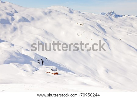 Snow mountain landscape with blue sky. Alps. France.