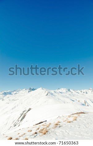 Snow mountain landscape with blue sky. Winter. Alps. France.