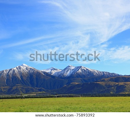 snow mountain of southern alpine alps in New Zealand with sunny sky - stock photo