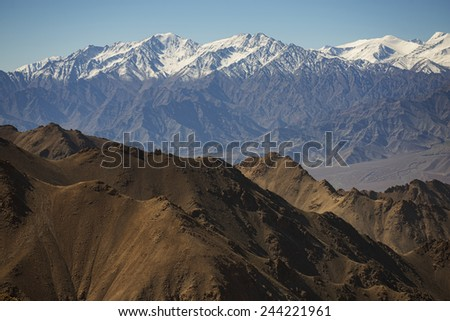 Snow mountain range at road side viewpoint on the way to Khardung La from Leh LADAKH, INDIA - September ,2014
