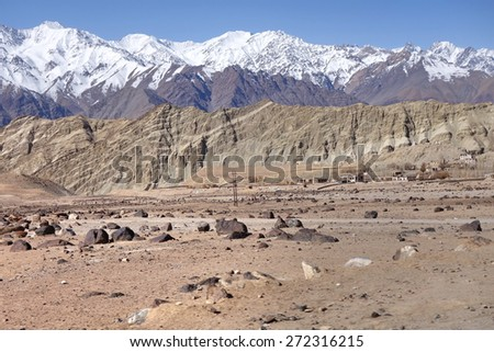 Snow mountain range at road side viewpoint on the way to Khardung La from Leh LADAKH, INDIA