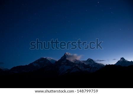 snow mountain under the stars - stock photo