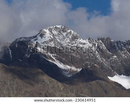 Snow mountains against blue sky in winter, Tibet, China - stock photo
