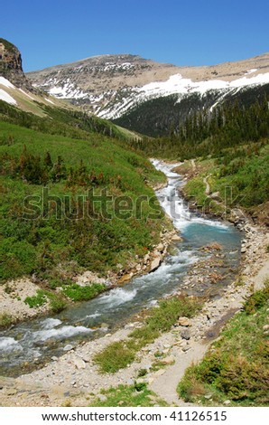 Snow mountains and creek in glacier national park, montana, usa - stock photo
