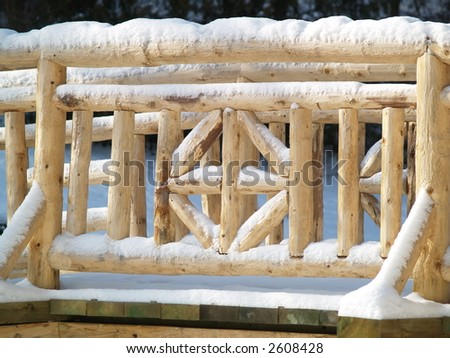 snow on a wooden bridge - stock photo